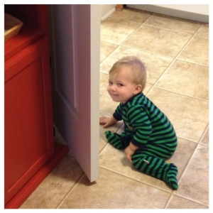mischievous squishy baby knocking the door into the furniture, he knows he's being bad look at that little face! haha