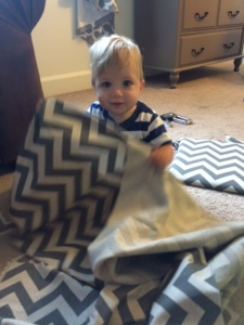 Baby P playing peek-a-boo with the fabric, lol!